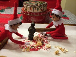 Elf on the shelf plays candy crush